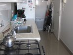 The fully equipped kitchen is spacious, modern and full of light