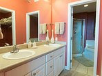 Double Vanity in Master Bedroom with walk in shower and jetted tub in background.
