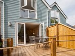 Private enclosed decking area with BBQ and seating for 4 people. There is a rotary washing line too.