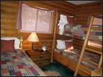 Third bedrooms has a set of bunks and twin bed and is located on main floor.