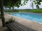 View of pool and countryside from pool bench