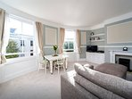 Spacious living room and dining area with fully equipped kitchen and huge comfy corner sofa