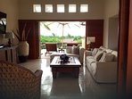 The living room is spacious yet cozy with easy access to the terrace and pool