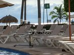Lots of lounge chairs around the pool