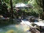 The view of the footbridge over the waterfalls, looking back at the house Daintree Secrets