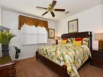 The 'tropical' king master bedroom on the ground floor with HD TV, Netflix