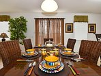 The kitchen breakfast table which seats 8 from the Cindy Crawford Collection