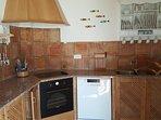 Kitchen - which includes fridge-freezer, dishwasher & oven