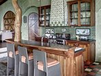 Gourmet kitchen with breakfast bar and a tree trunk that reaches to the ceiling