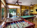 Large game room with pool,foosball, a full wet bar, and large screen TV