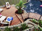 The wooden plank deck for relaxing at the pool