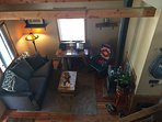 Cozy living room with newly installed gas fireplace. This is the view from the sleeping loft.