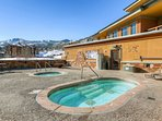 Rooftop hot tub available to all Guests of Sundial Lodge with stunning mountain views of Iron Mountain, Ninety-Nine...