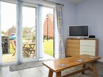 South Facing Lounge with Bifold doors to Patio.  TV&DVD, Free WiFi, sideboard with Games & DVDs