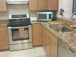 Stainless Steel appliances throughout  Kitchen fully stocked with many extras