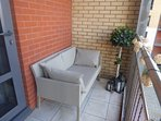 Balcony with comfortable seating and fantastic view.