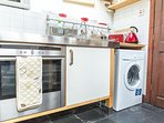 The kitchen - oven, hob, microwave, fridge, washing machine