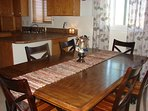 An extra leaf and chairs are available for this farmhouse table