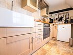 Kitchen - oven, microwave, hob, fridge, washing machine