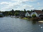 River Bure from Wroxham Bridge looking towards the cottages