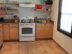 Kitchen, granite counter tops, all necessary items to cook and eat provided