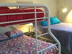 Second bedroom with twin/full bunk bed, and queen bed