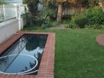Spacious ground level one bedroom house with garden and pool