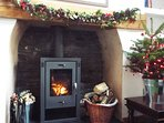 Large wood burner with logs supplied.
