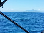 Sailing deep sea with Mount Vesuvius in the background