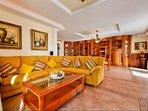 Lounge area with comfy sofa, Tv, music system and dinginarea
