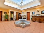 hacienda style courtyard leading to bedrooms and bathroom