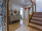 Large entrance with oak and glass stairs leading to the living area. Underfloor heating!