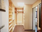 The walk in wardrobe for the master suite