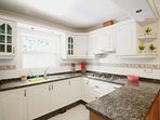 The kitchen at villa Mollie includes dishwasher and coffee machine