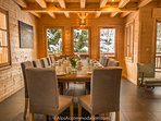 The chalet boasts an impressive dining area with beautiful wood dining table