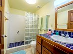 Lower level bath with glass tiled shower
