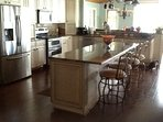 Updated kitchen with large bar island.  The upstairs dining room includes 2 separate dining tables