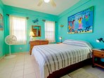 Second bedroom with queen bed & Belizean art!