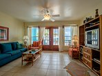 Ample living room leading directly to front porch and pool and beach beyond!