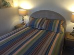 New bed, wicker furnishings.