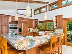 Kitchen with a beautiful granite-top island.