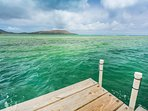 The dock beyond the private ocean access gate, where you can launch stand-up paddle boards and kayaks or go fishing.