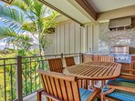 Main lanai dining table and barbecue grill.