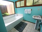 Master bath, which includes a tub and separate shower.