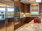The sleek kitchen has everything needed for preparing meals at home.