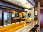 Kitchen and the fruit basket provided to all guests compliments of Elite Pacific Properties