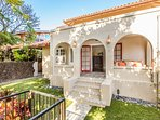 Front entry showcases the Spanish Colonial Revival style.