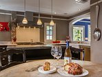 Dining room and kitchen. This chef's dream kitchen includes top-of-the-line appliances and extra amenities like a...