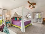 Master bedroom, located on the top floor, with peak-a-boo ocean and Diamond Head views!