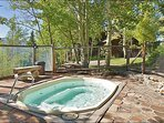 Outdoor Hot Tub is a short walk from the townhome